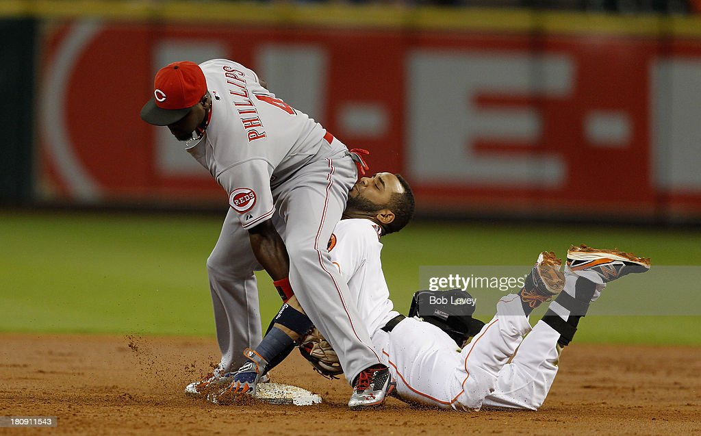 Jonathan Villar #6 of the Houston Astros is tagged out by Brandon Phillips #4 of the Cincinnati Reds attempting to stretch a single in to a double in the first inning at Minute Maid Park on September 17, 2013 in Houston, Texas.