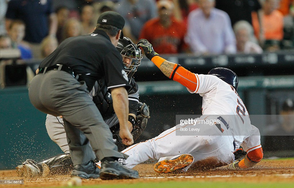 Jonathan Villar of the Houston Astros is tagged out by Tyler Flowers of the Chicago White Sox as he slides into home plate as he attempted to turn a...