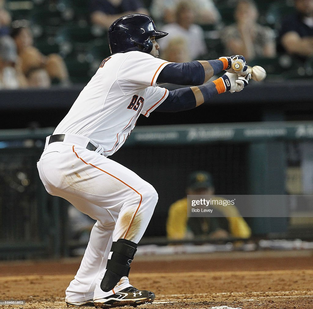 Jonathan Villar #6 of the Houston Astros lays down a bunt in the third inning against the Oakland Athletics at Minute Maid Park on July 24, 2013 in Houston, Texas.
