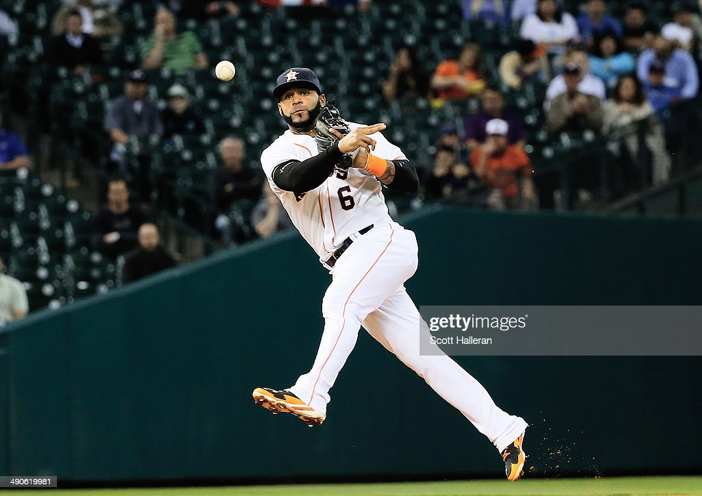Jonathan Villar #6 of the Houston Astros makes a play in the infield in the fourth inning of their game against the Texas Rangers at Minute Maid Park on May 14, 2014 in Houston, Texas.