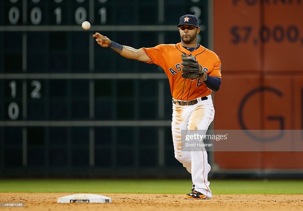 <a gi-track='captionPersonalityLinkClicked' href=/galleries/search?phrase=Jonathan+Villar&family=editorial&specificpeople=8981472 ng-click='$event.stopPropagation()'>Jonathan Villar</a> #6 of the Houston Astros makes a throw at shortstop iin the eighth inning of their game against the Chicago White Sox at Minute Maid Park on May 16, 2014 in Houston, Texas.