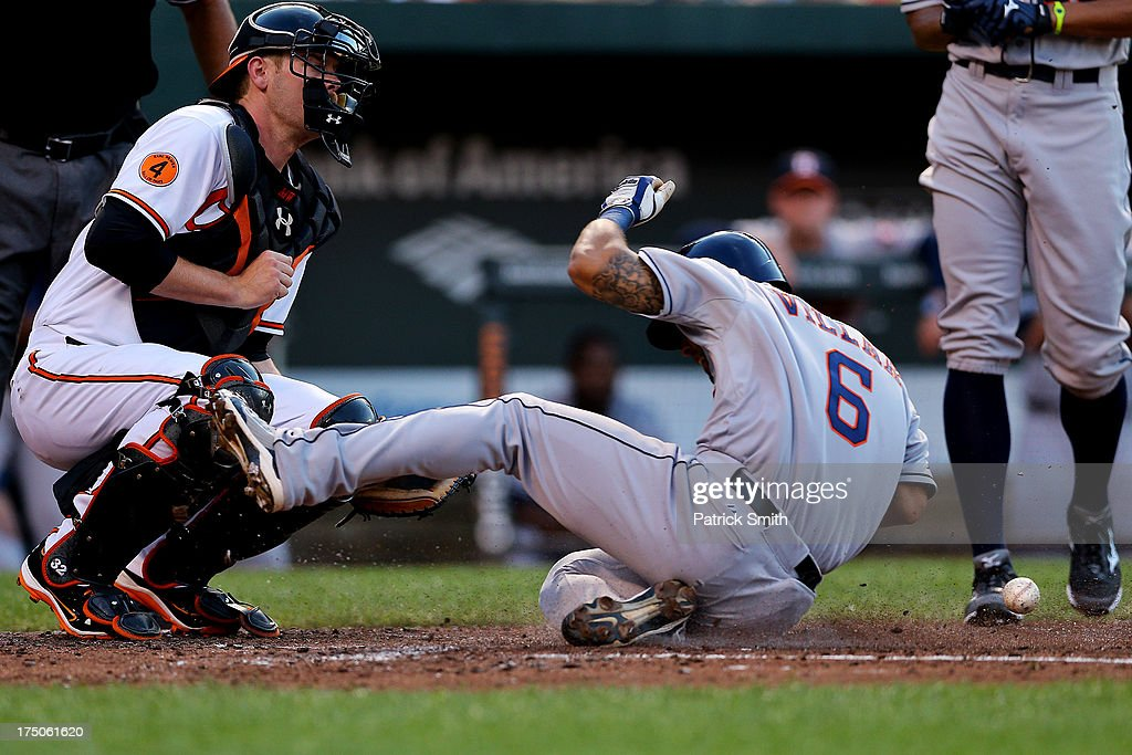 Jonathan Villar #6 of the Houston Astros steals home to score a run in front of catcher <a gi-track='captionPersonalityLinkClicked' href=/galleries/search?phrase=Matt+Wieters&family=editorial&specificpeople=4498276 ng-click='$event.stopPropagation()'>Matt Wieters</a> #32 of the Baltimore Orioles in the third inning at Oriole Park at Camden Yards on July 30, 2013 in Baltimore, Maryland.