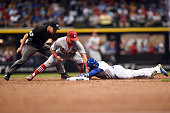 Jonathan Villar of the Milwaukee Brewers beats a tag by Kolten Wong of the St Louis Cardinals during the fifth inning of a game at Miller Park on...
