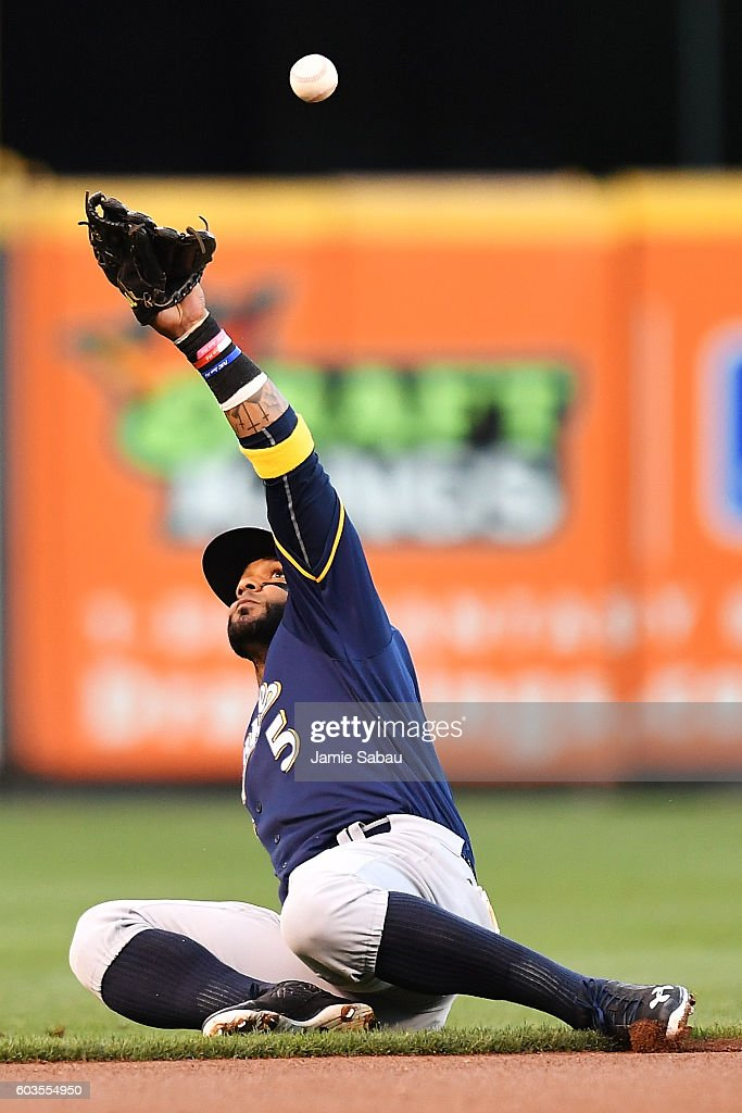 Jonathan Villar #5 of the Milwaukee Brewers bobbles a sharply hit ground ball in the first inning against the Cincinnati Reds at Great American Ball Park on September 12, 2016 in Cincinnati, Ohio.