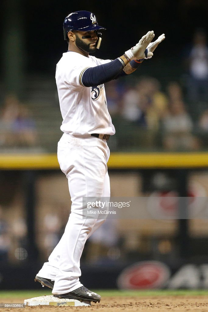 Jonathan Villar of the Milwaukee Brewers calls for time after hitting a RBI double during the seventh inning against the Colorado Rockies at Miller...