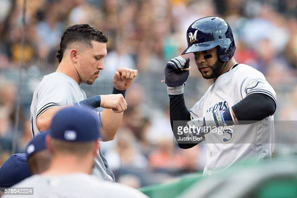 Jonathan Villar of the Milwaukee Brewers celebrates with Hernan Perez after hitting a solo home run in the third inning during the game against the...