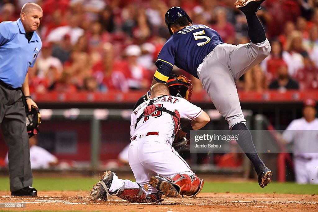 Jonathan Villar #5 of the Milwaukee Brewers collides with catcher Tucker Barnhart #16 of the Cincinnati Reds after being tagged out at home plate in the seventh inning at Great American Ball Park on September 12, 2016 in Cincinnati, Ohio. Cincinnati defeated Milwaukee 3-0.
