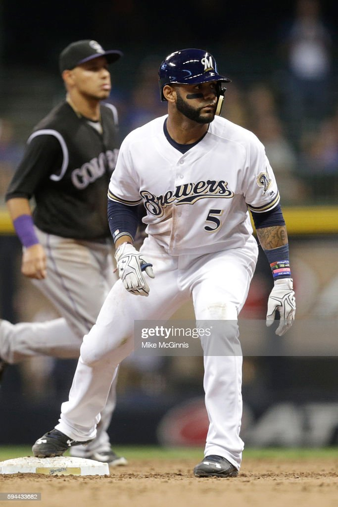 Jonathan Villar of the Milwaukee Brewers hits a RBI double during the seventh inning against the Colorado Rockies at Miller Park on August 23 2016 in...