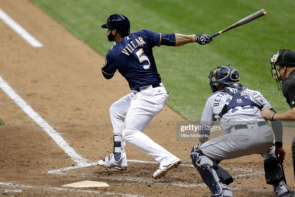 Jonathan Villar of the Milwaukee Brewers hits a single in the eighth inning against the San Diego Padres at Miller Park on May 12 2016 in Milwaukee...