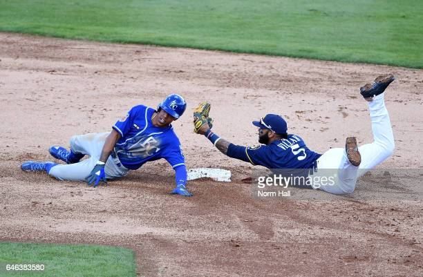 Jonathan Villar of the Milwaukee Brewers holds the ball up after tagging out Raul Mondesi of the Kansas City Royals at second base during the third...