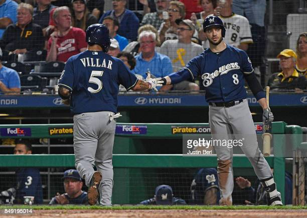 Jonathan Villar of the Milwaukee Brewers is greeted by Ryan Braun after coming around to score on an RBI single by Neil Walker in the sixth inning...