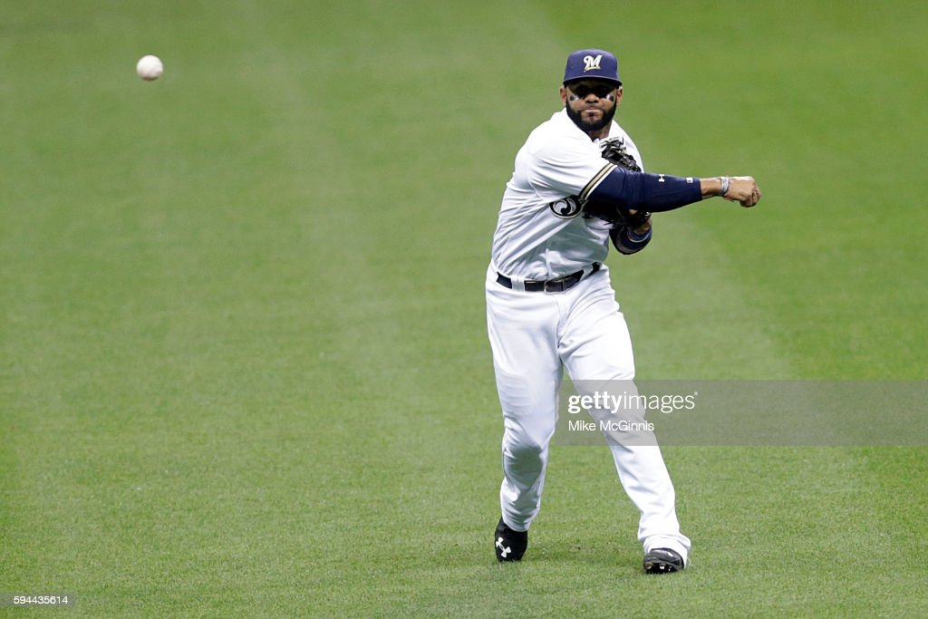 Jonathan Villar of the Milwaukee Brewers makes the throw to first base to retire David Descalso during the third inning against the Colorado Rockies...