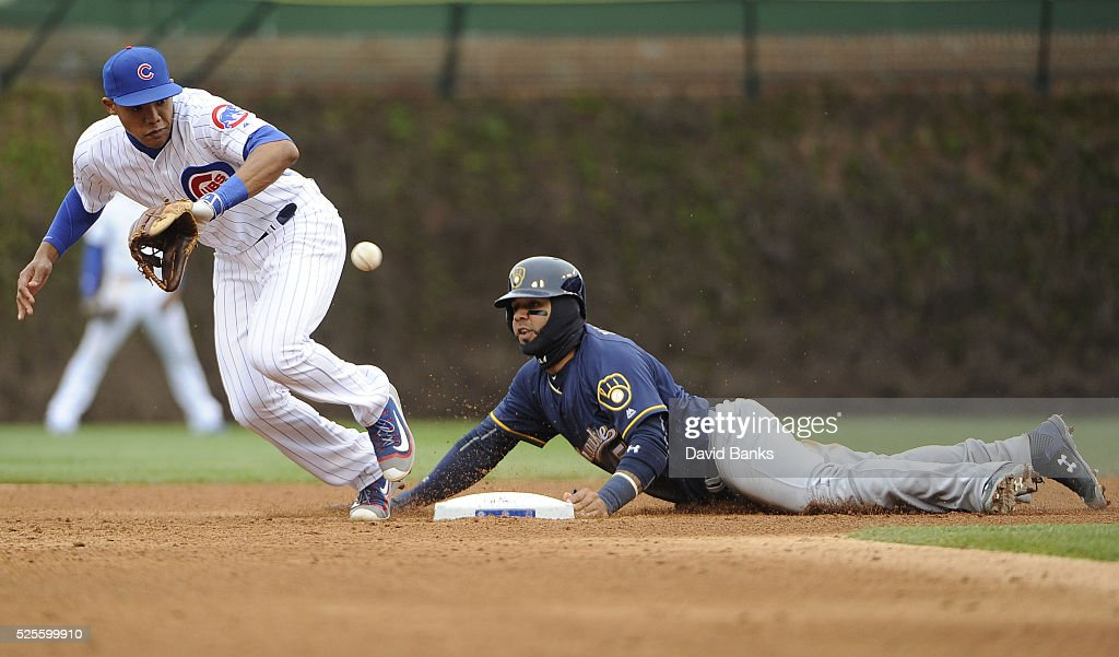 Jonathan Villar #5 of the Milwaukee Brewers steals second base as Addison Russell #27 of the Chicago Cubs takes the throw during the fifth inning on April 28, 2016 at Wrigley Field in Chicago, Illinois.
