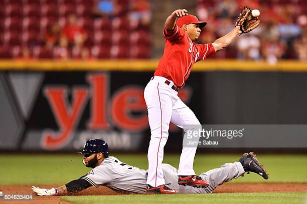 Jonathan Villar of the Milwaukee Brewers steals second base in the sixth inning as Ivan De Jesus Jr #3 of the Cincinnati Reds takes the throw from...