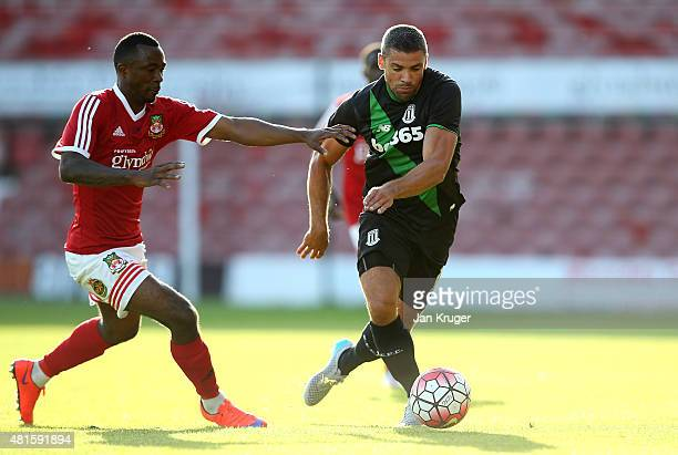 Jonathan Walters of Stoke City battles with Javan Vidal of Wrexham during the pre season friendly match between Wrexham and Stoke City at Racecourse...