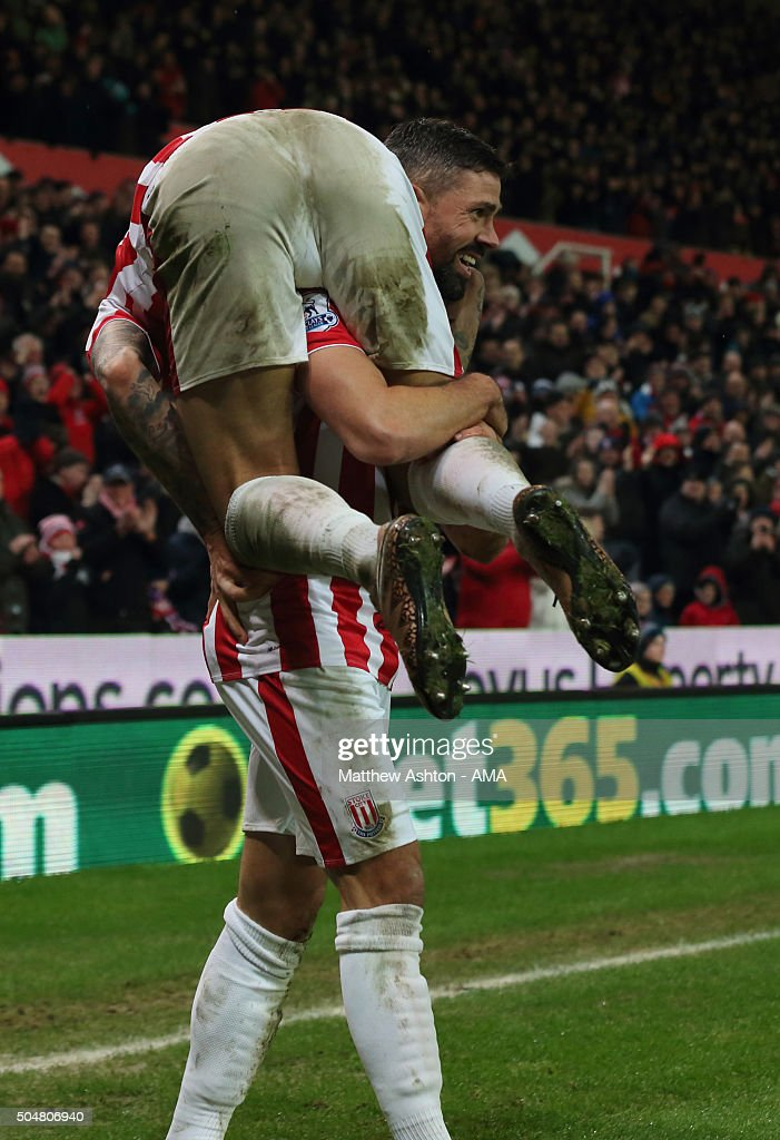 Jonathan Walters of Stoke City celebrates after scoring a goal to make it 1-0 with Joselu during the Barclays Premier League match between Stoke City and Norwich City at the Britannia Stadium on January 13, 2016 in Stoke-on-Trent, England.