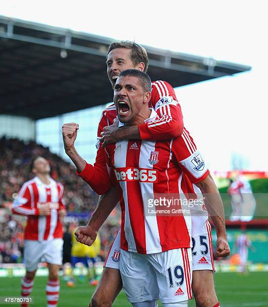 Jonathan Walters of Stoke City celebrates his goal with Peter Crouch during the Barclays Premier League match between Stoke City and Arsenal at...