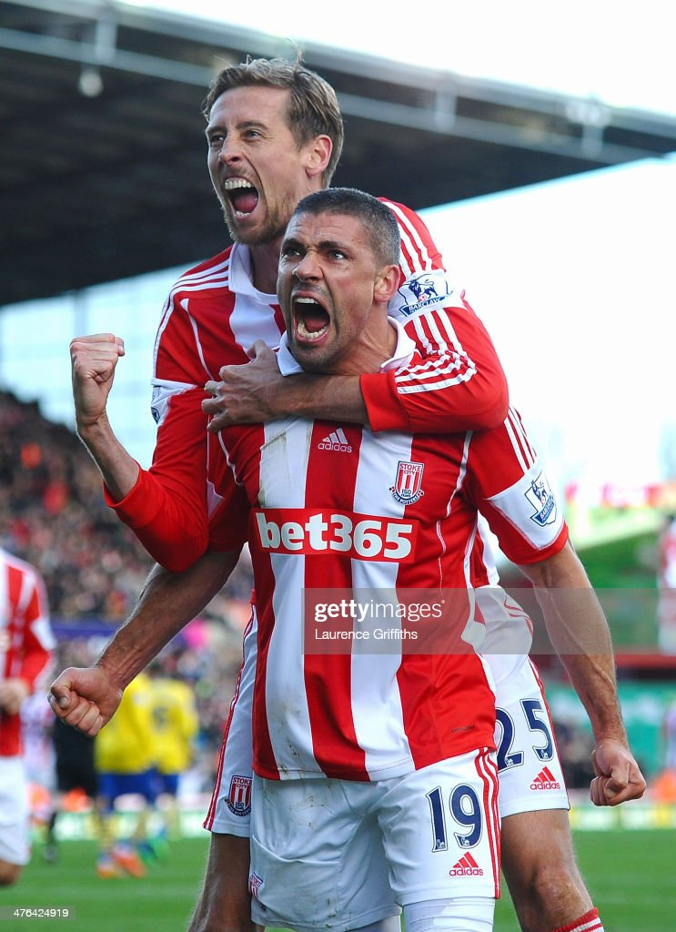 Jonathan Walters of Stoke City celebrates his goal with Peter Crouch during the Barclays Premier League match between Stoke City and Arsenal at Britannia Stadium on March 1, 2014 in Stoke on Trent, England.