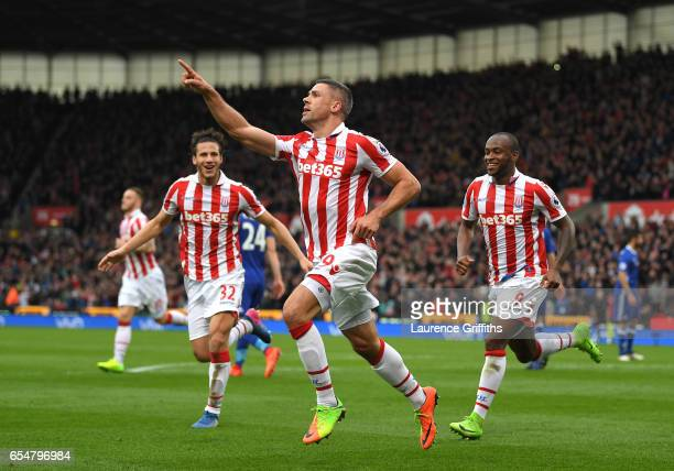 Jonathan Walters of Stoke City celebrates scoring his sides first goal during the Premier League match between Stoke City and Chelsea at Bet365...