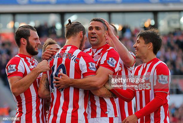 Jonathan Walters of Stoke City celebrates scoring his team's first goal with his team mates during the Barclays Premier League match between Stoke...