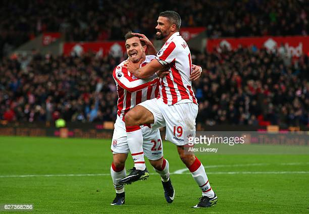 Jonathan Walters of Stoke City celebrates scoring his team's first goal with his team mates Xherdan Shaqiri during the Premier League match between...
