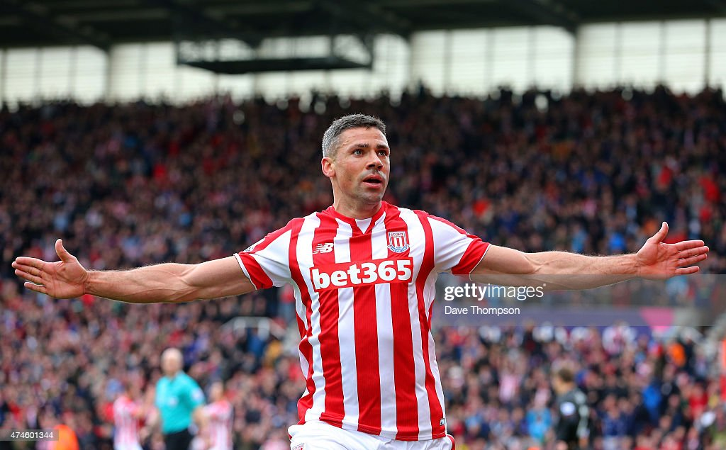 Jonathan Walters of Stoke City celebrates scoring his team's third goal during the Barclays Premier League match between Stoke City and Liverpool at Britannia Stadium on May 24, 2015 in Stoke on Trent, England.