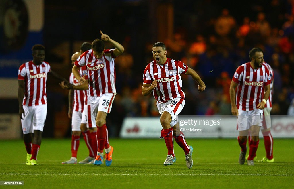 <a gi-track='captionPersonalityLinkClicked' href=/galleries/search?phrase=Jonathan+Walters&family=editorial&specificpeople=3389578 ng-click='$event.stopPropagation()'>Jonathan Walters</a> of Stoke City celebrates victory with team mates after the penalty shoot-out during the Capital One Cup second round match between Luton Town and Stoke City at Kenilworth Road on August 25, 2015 in Luton, England.
