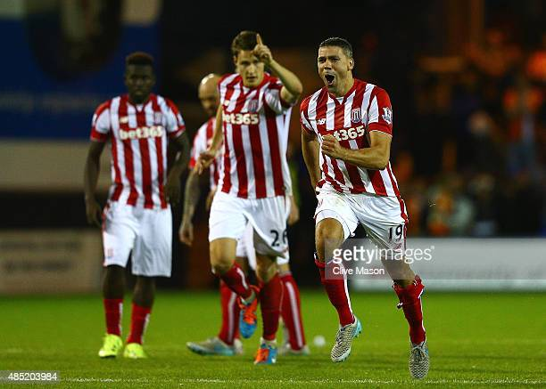 Jonathan Walters of Stoke City celebrates victory with team mates after the penalty shootout during the Capital One Cup second round match between...