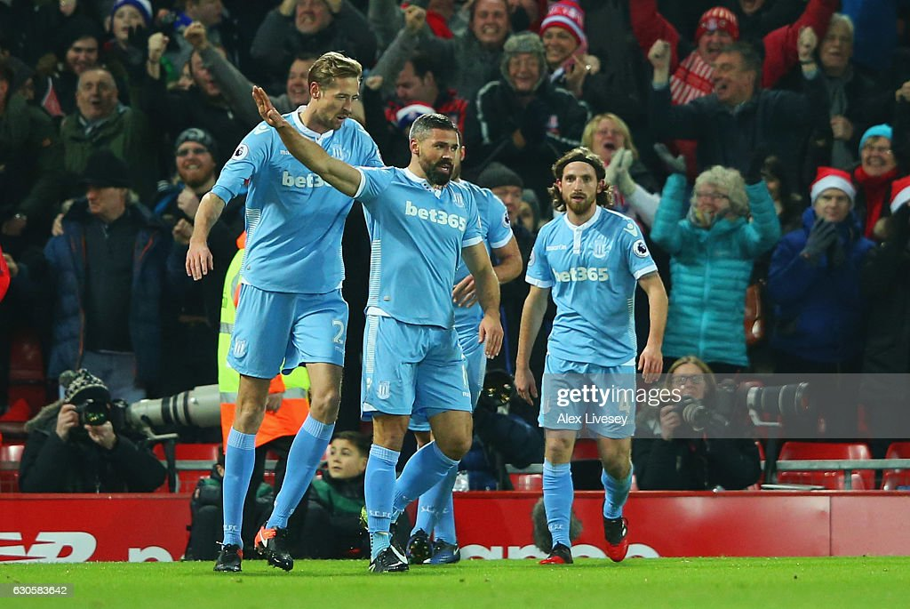 Jonathan Walters of Stoke City (19) celebrates with team mates as he scores their first goal during the Premier League match between Liverpool and Stoke City at Anfield on December 27, 2016 in Liverpool, England.
