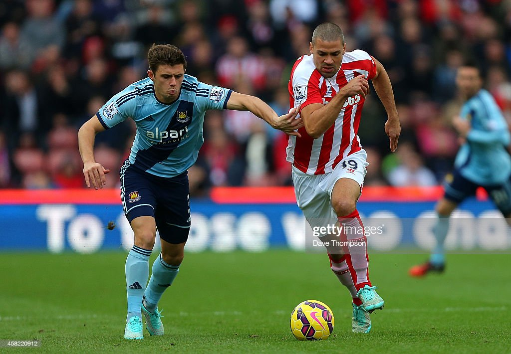 Jonathan Walters of Stoke City competes with Aaron Cresswell of West Ham during the Barclays Premier League match between Stoke City and West Ham United at the Britannia Stadium on November 1, 2014 in Stoke on Trent, England.