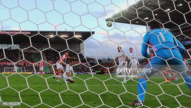 Jonathan Walters of Stoke City heads towards goal to score their second goal during the Barclays Premier League match between Stoke City and Swansea...