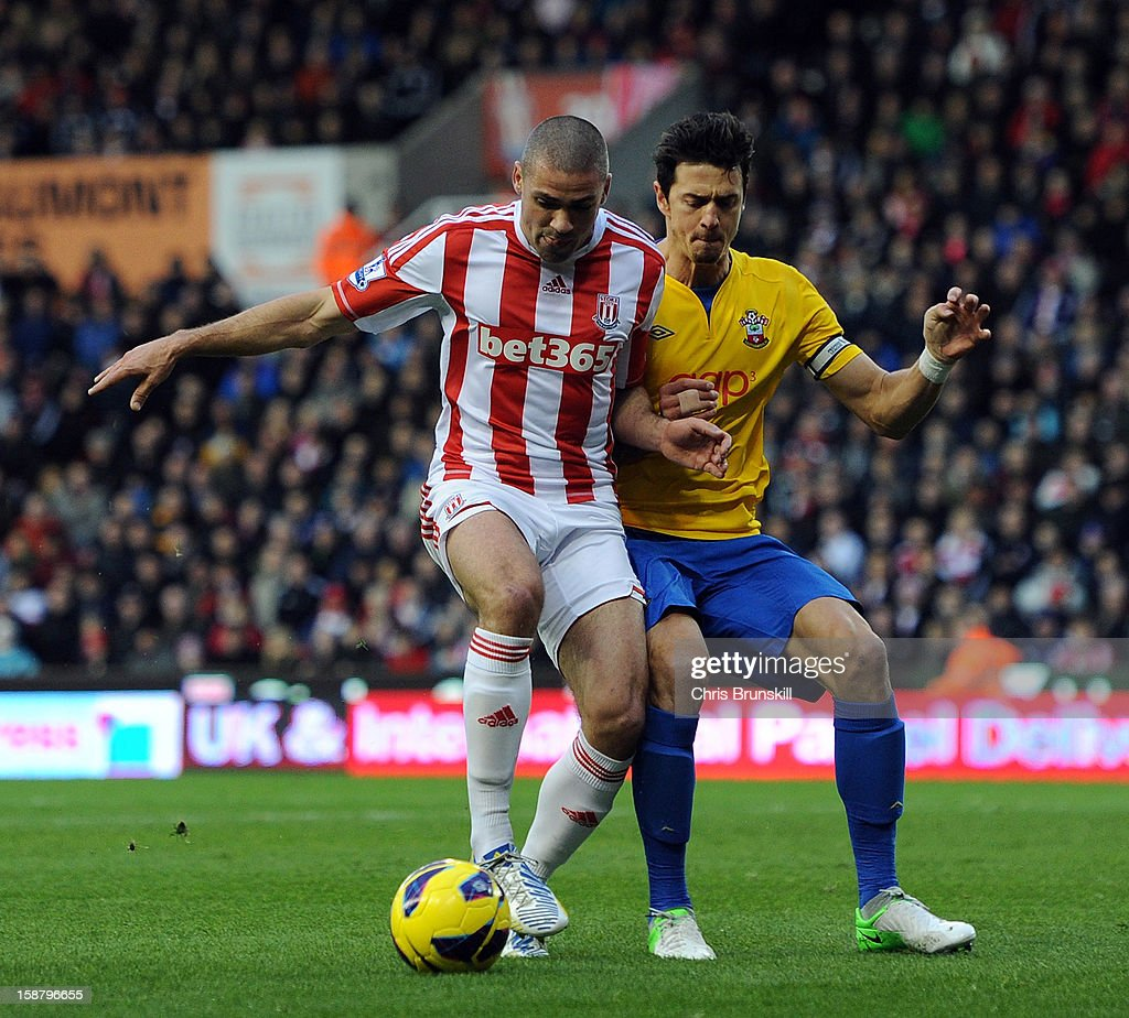 Jonathan Walters of Stoke City in action with Jose Fonte of Southampton during the Barclays Premier League match between Stoke City and Southampton at Britannia Stadium on December 29, 2012 in Stoke on Trent, England.