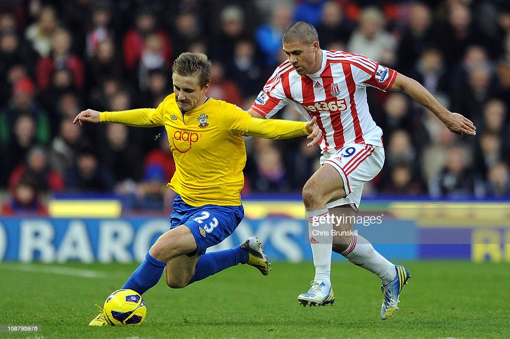 Jonathan Walters (R) of Stoke City in action with Luke Shaw of Southampton during the Barclays Premier League match between Stoke City and Southampton at Britannia Stadium on December 29, 2012 in Stoke on Trent, England.