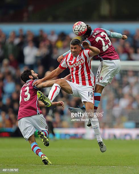 Jonathan Walters of Stoke City is challenged by Jordan Amavi and Jose Angel Crespo of Aston Villa during the Barclays Premier League match between...