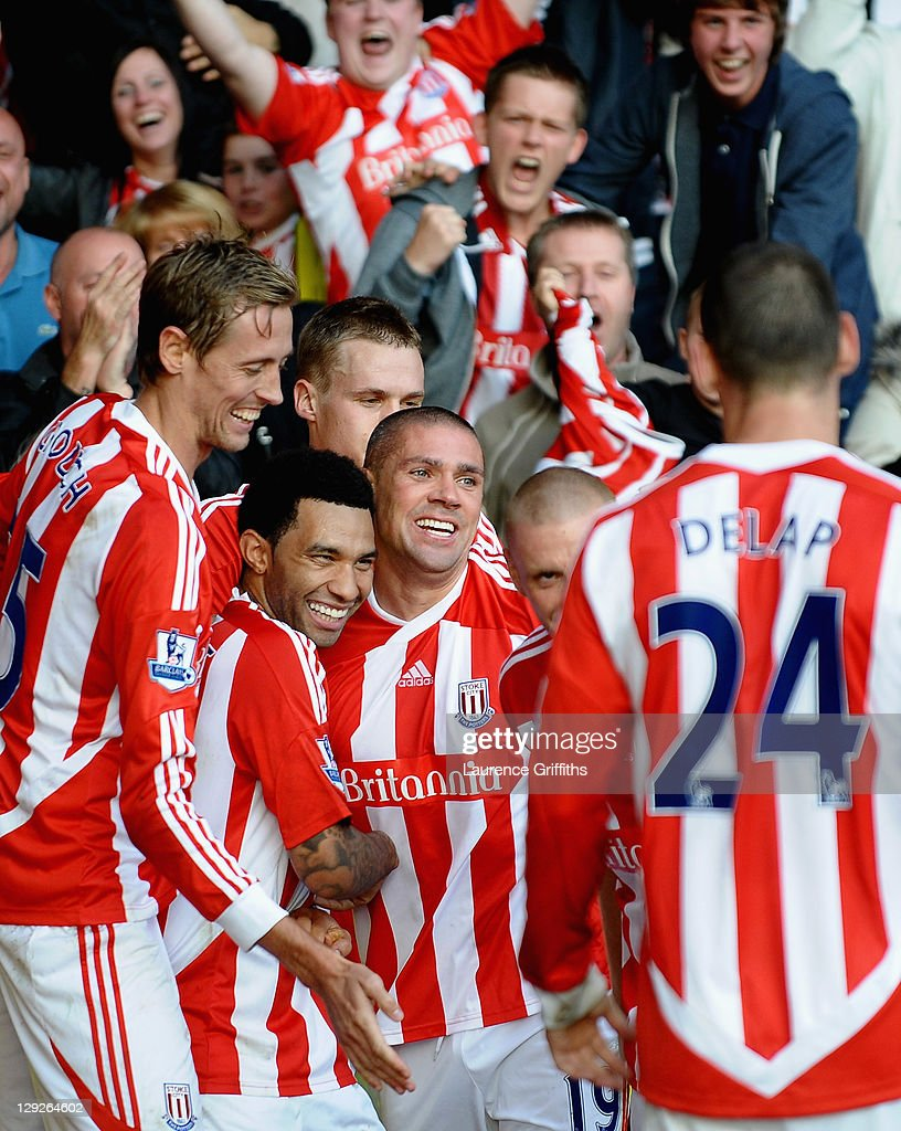 Jonathan Walters of Stoke City is mobbed after scoring the first goal during the Barclays Premier League match between Stoke City and Fulham at Britannia Stadium on October 15, 2011 in Stoke on Trent, England.