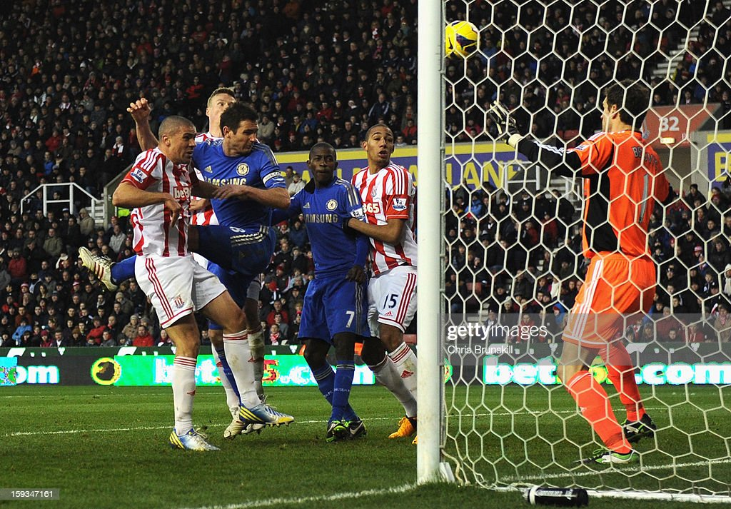<a gi-track='captionPersonalityLinkClicked' href=/galleries/search?phrase=Jonathan+Walters&family=editorial&specificpeople=3389578 ng-click='$event.stopPropagation()'>Jonathan Walters</a> of Stoke City scores his second own goal to make the score 0-2 during the Barclays Premier League match between Stoke City and Chelsea at the Britannia Stadium on January 12, 2013, in Stoke-on-Trent, England.
