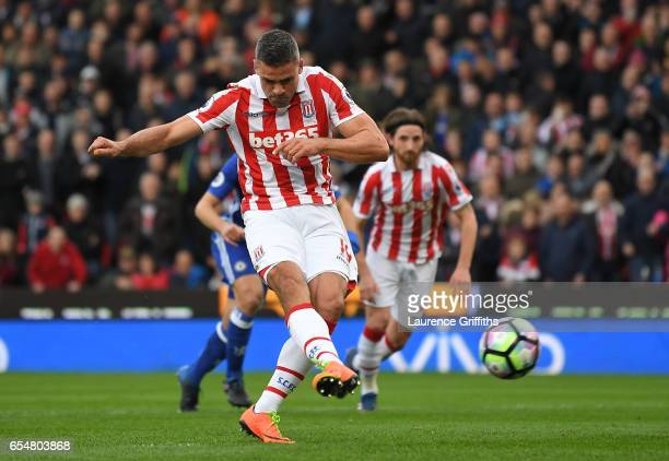 Jonathan Walters of Stoke City scores his sides first goal from the penalty spot during the Premier League match between Stoke City and Chelsea at...