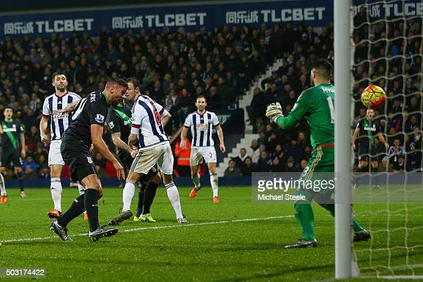 Jonathan Walters of Stoke City scores his team's first goal past Boaz Myhill of West Bromwich Albion during the Barclays Premier League match between...