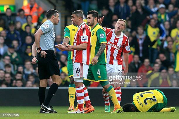 Jonathan Walters of Stoke is shown the red card by referee Andre Marriner following his challenge on Alexander Tettey of Norwich during the Barclays...
