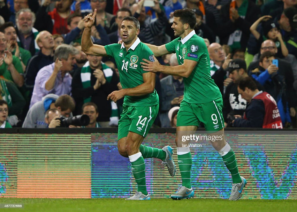 <a gi-track='captionPersonalityLinkClicked' href=/galleries/search?phrase=Jonathan+Walters&family=editorial&specificpeople=3389578 ng-click='$event.stopPropagation()'>Jonathan Walters</a> of the Republic of Ireland (14) celebrates with <a gi-track='captionPersonalityLinkClicked' href=/galleries/search?phrase=Shane+Long&family=editorial&specificpeople=661194 ng-click='$event.stopPropagation()'>Shane Long</a> (9) as he scores their first goal during the UEFA EURO 2016 Group D qualifying match between Republic of Ireland and Georgia at Aviva Stadium on September 7, 2015 in Dublin, Ireland.