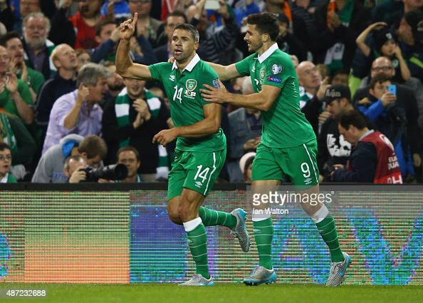 Jonathan Walters of the Republic of Ireland celebrates with Shane Long as he scores their first goal during the UEFA EURO 2016 Group D qualifying...
