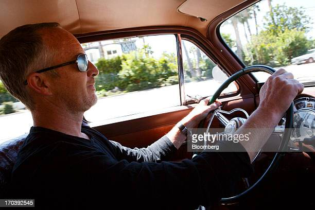 Jonathan Ward owner and head designer of Los Angelesbased custom automobile maker Icon sits behind the wheel of his 1952 Chrysler Group LLC Town...