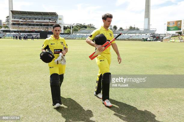 Jonathan Wells and Mitchell Marsh of the Warriors leave the field at the break during the JLT One Day Cup match between Victoria and Western...