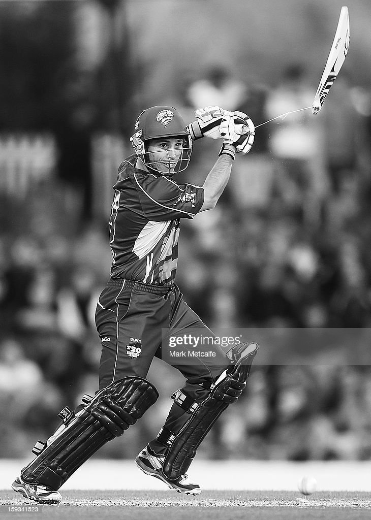 Jonathan Wells of the Hurricanes breaks his bat whilst batting during the Big Bash League match between the Hobart Hurricanes and the Brisbane Heat at Blundstone Arena on January 12, 2013 in Hobart, Australia.