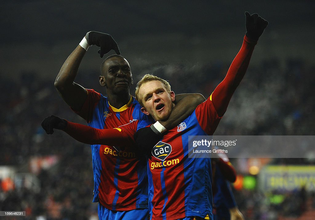 Jonathan Williams and Yannick Bolasie celebrate the equalising goal during the FA Cup with Budweiser Third Round replay match between Stoke City and Crystal Palace at Britannia Stadium on January 15, 2013 in Stoke on Trent, England.