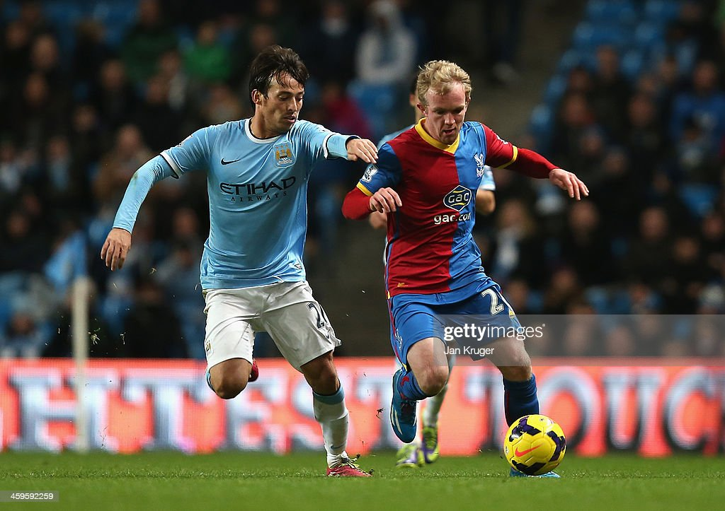 Jonathan Williams of Crystal Palace competes with <a gi-track='captionPersonalityLinkClicked' href=/galleries/search?phrase=David+Silva&family=editorial&specificpeople=675795 ng-click='$event.stopPropagation()'>David Silva</a> of Manchester City during the Barclays Premier League match between Manchester City and Crystal Palace at the Etihad Stadium on December 28, 2013 in Manchester, England.