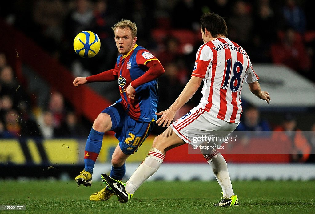Jonathan Williams of Crystal Palace is challenged by <a gi-track='captionPersonalityLinkClicked' href=/galleries/search?phrase=Dean+Whitehead&family=editorial&specificpeople=185232 ng-click='$event.stopPropagation()'>Dean Whitehead</a> of Stoke during the FA Cup with Budweiser Third Round match between Crystal Palace and Stoke City at Selhurst Park on January 5, 2013 in London, England.