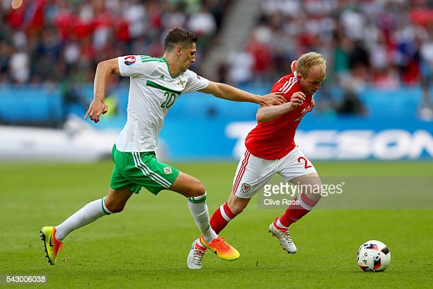 Jonathan Williams of Wales and Craig Cathcart of Northern Ireland compete for the ball during the UEFA EURO 2016 round of 16 match between Wales and...
