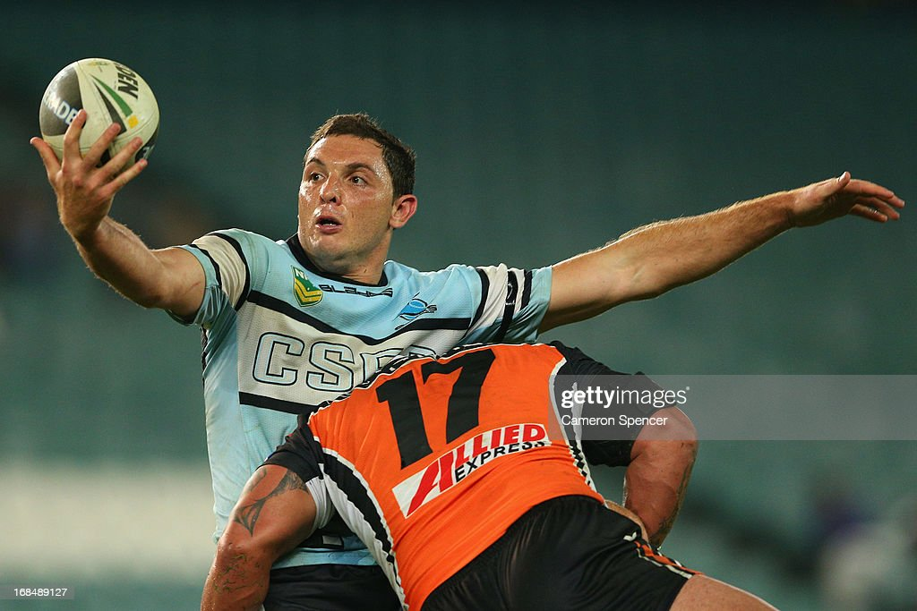 Jonathan Wright of the Sharks juggles the ball during the round nine NRL match between the Wests Tigers and the Cronulla Sharks at Allianz Stadium on May 10, 2013 in Sydney, Australia.