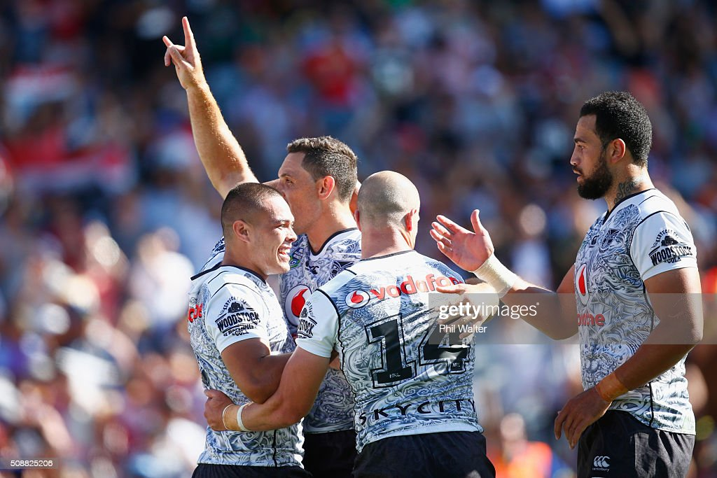 Jonathan Wright of the Warriors celebrates the try of Tuimoala Lolohea (L) during the 2016 Auckland Nines semifinal match between the Warriors and the Titans at Eden Park on February 7, 2016 in Auckland, New Zealand.